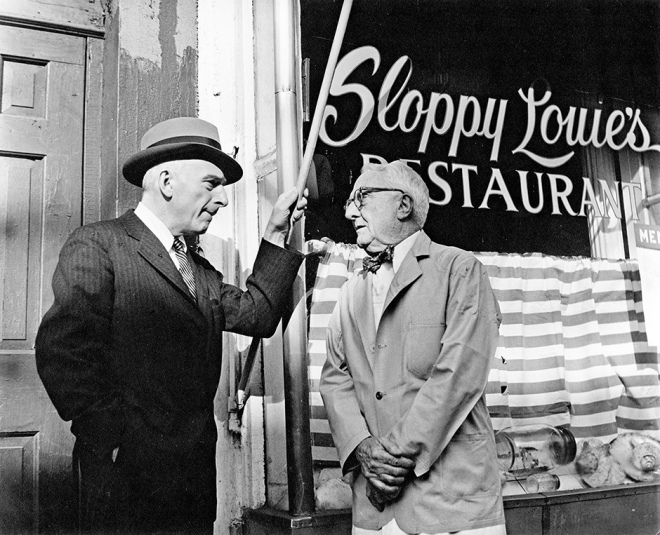 Joseph Mitchell outside Sloppy Louie's restaurant with Louis Morino, the subject of Mitchell's 1952 <i>New Yorker</i> profile 'Up in the Old Hotel'