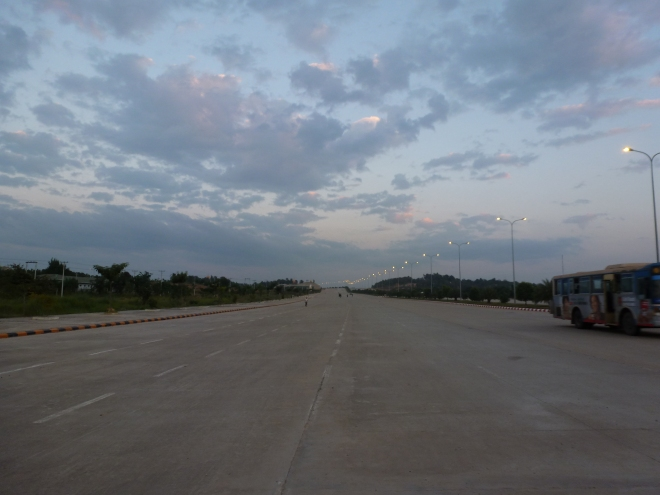 One half of a wide boulevard at Naypyidaw, by Hybernator via Wikimedia Commons